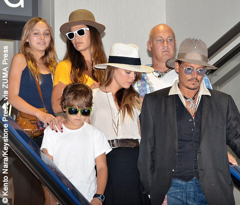 Left to right: Lily-Rose Depp, Jack Depp, a nanny, Amber Heard, a bodyguard and Johnny Depp