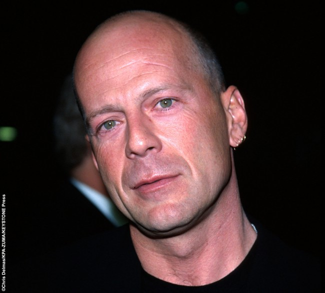 """Bruce Willis, the Die Hard and Sin City star (A.K.A. Buck, according to his yearbook signing), penned a surprising response to a question about his future. His aim after high school? """"To become deliriously happy or a professional harp player."""" Unless he's hiding his harp playing skills, we imagine he went for the happiness route."""