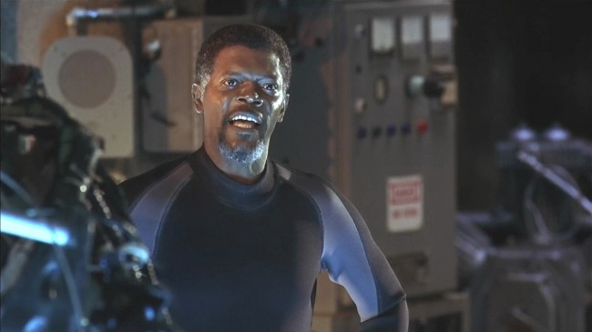 While trapped in an underwater lab facility in the middle of the Atlantic with genetically modified supersharks on the loose, corporate executive Russell (Samuel L. Jackson) decides it's a really good time to stand by open water and make a speech. The remaining (i.e., not chewed up) crew is exhausted, bickering, and probably going a […]