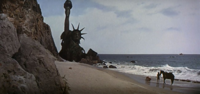 George Taylor (Charlton Heston) – After human couple George and Zira (Kim Hunter) escape from their ape captors, they find themselves free on an isolated beach. Riding a mighty steed across the sunny shoreline, they glance up to discover a sunken Statue of Liberty — a very long way away from its home in New […]