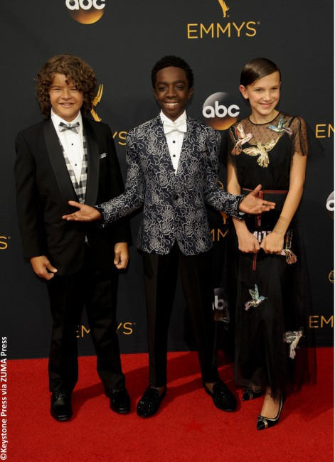 The kids of Stranger Things — namely Millie Bobby Brown, Gaten Matarazzo and Caleb McLaughlin — emerged from the Upside Down and made their Emmy red carpet debut in style. Millie looked chic in a Valentino Red gown with embroidered birds along the neckline and skirt, which she accentuated with pointy-toed shoes and a customized […]