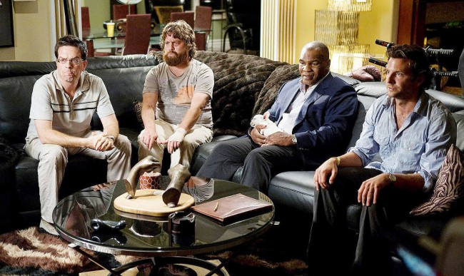 """The image of Mike Tyson rocking out to Phil Collins' """"In the Air Tonight"""" will forever be ingrained in our minds thanks to the boxer's legendary cameo in The Hangover. The highly divisive former athlete literally punches his way back into pop culture relevancy when he and his equally large bodyguard track down the hangover […]"""