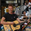 Chris Martin performs benefit concert at homeless shelter