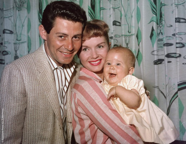 Carrie Fisher was born to legendary movie star Debbie Reynolds and singer Eddie Fisher on October 21, 1956.