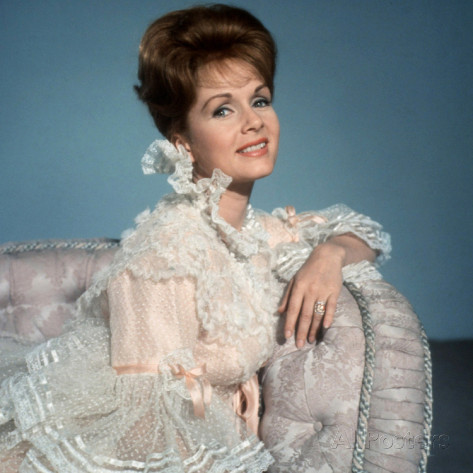 Debbie Reynolds in a movie still from The Unsinkable Molly Brown