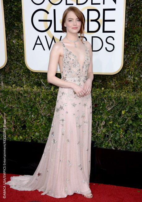 Emma Stone stunned in a nude Valentino Haute Couture gown that flaunted a plunging neckline and accentuated with stars, an apt choice considering her award-winning film La La Land. The actress accessorized her look with Tiffany & Co. jewels and Jimmy Choo shoes. Her makeup was soft as she opted for NARS Vevet Matte Skin […]