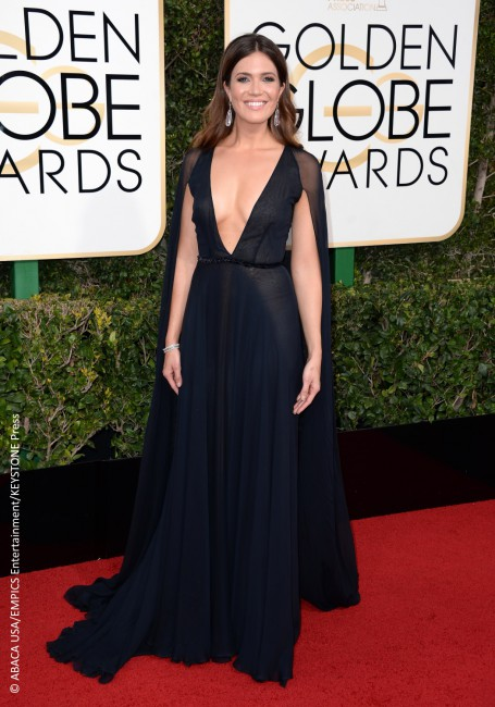 Mandy Moore, who was nominated for Best Performance by an Actress in a Supporting Role for her new show This Is Us, flaunted a cleavage-bearing Naeem Khan gown attached to a sheer cape, another trend that has been taking over the runways at fashion week. She completed the look with teardrop earrings and a diamond […]