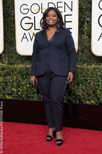 When it comes to a suit, fit is everything. Apparently Octavia Spencer did not get the memo, rocking an extremely ill-fitting Laura Boschi navy blue tuxedo that did nothing for her lovely figure. While we'll pass on the duds, we'll gladly borrow the Golden Globe winner's stunning 40-carat Lorraine Schwartz emerald cocktail ring.