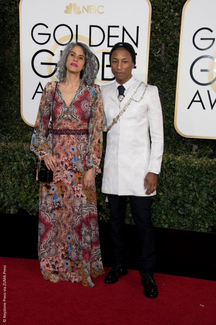 Known for his eccentric fashion sense, Pharrell Williams took to the red carpet in a much-more confusing outfit than ususal. Why the Golden Globe-nominated producer decided to sport a beanie (plus a beaded sash) with his very dapper white printed Chanel suit jacket is truly beyond us.
