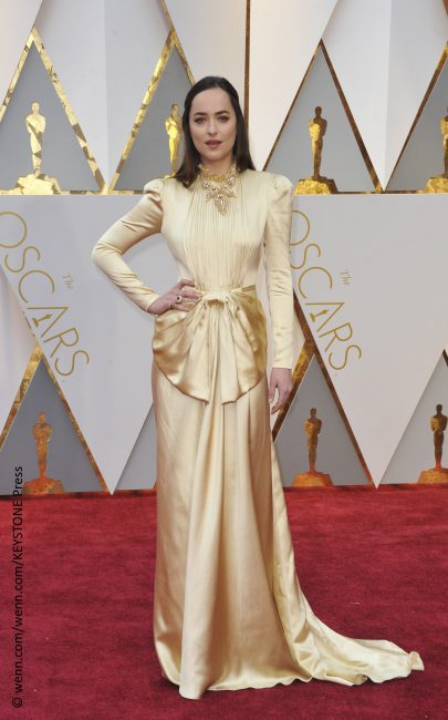 The Fifty Shades Darker star had about 50 issues with her look. We're thinking Dakota Johnson tried to pay tribute to a past era with her gold Gucci gown, but it was more of a mess than anything. The color was far from flattering for her complexion, and the overwhelming bow around her waist and […]