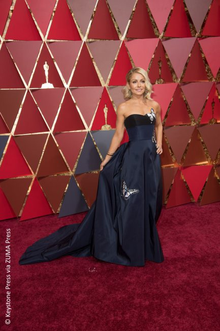 The color worked, but that's about it. Kelly Ripa's navy blue Carolina Hererra gown with butterfly patches flew her directly onto our worst dressed list.