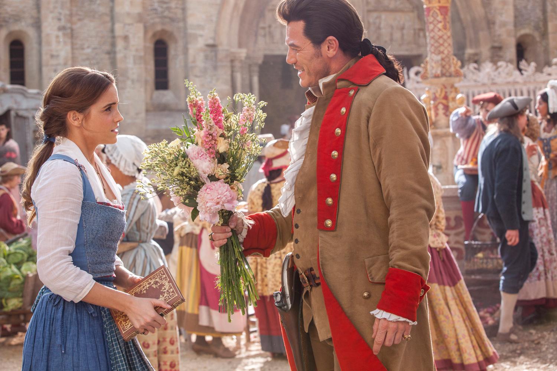 Belle (Emma Watson) and Gaston (Luke Evans)