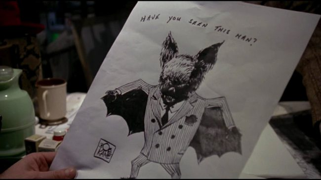 Batman superfans will think this one is obvious, but you've got to look quick to catch it. At the beginning of Batman (1989), when Alexander Knox walks into his office, he's handed a sketch of what they dubbed The Batman. Take a look at the signature. It's none other than the name of Bob Kane, […]