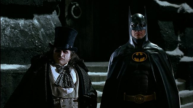 Michael Keaton teamed up with director Tim Burton once again to portray everyone's favorite Caped Crusader in Batman Returns. Besides giving moviegoers a good time at the theater, the film also gave us one of the best portrayals of villains the Penguin (played by Danny DeVito) and Catwoman (played by Michelle Pfeiffer) to date!