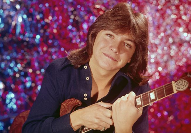 David Cassidy became an international superstar at age 20 when he was cast as teen heartthrob Keith Partridge on The Partridge Family. He began performing concerts all over the world in addition to starring on the sitcom for the next four years. Later, he became known for his stage performances, including in Las Vegas and […]