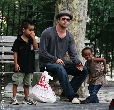 Brad Pitt with two of his kids at park