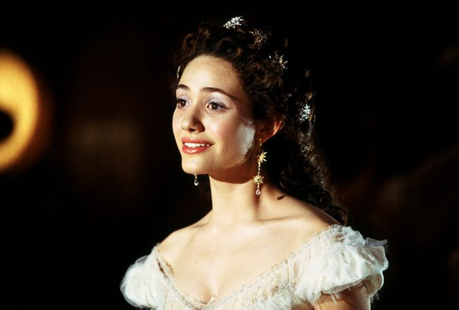 "The 2004 musical drama The Phantom of the Opera, based on the stage hit, starred a young Emmy Rossum. Not only is Emmy beautiful, she also has an angelic voice. Listen to her sing ""Think of Me"" or the solemn ""Wishing You Were Somehow Here Again."" Of course, Gerard Butler as the Phantom turns in […]"
