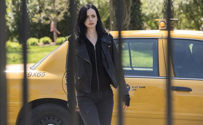 Krysten Ritter plays whiskey-drinking, super-strong Jessica Jones on the Netflix show Marvel's Jessica Jones. Jessica's got her flaws. Heck, we all do. But Krysten kicks ass and makes the superhero as realistic as possible.