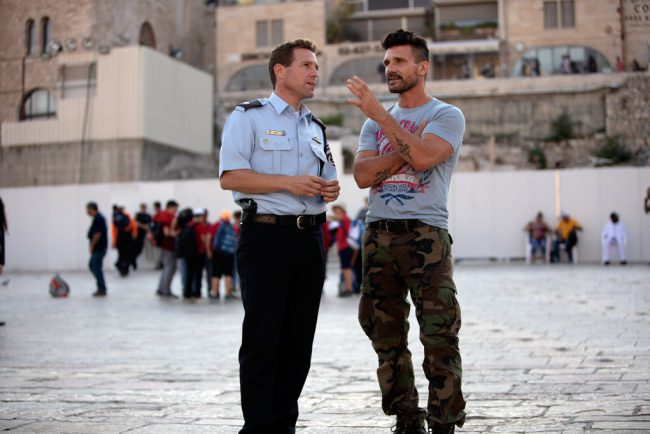 Actor and martial artist Frank Grillo explores and experiences diverse fighting techniques found in cultures around the world. He's pictured here speaking with Police Officer Micky Rosenfeld in Israel.
