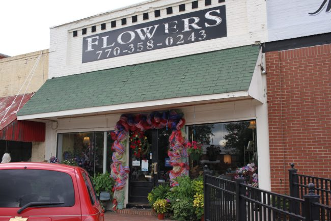 The flower store on Market Street can also be seen in the shots.