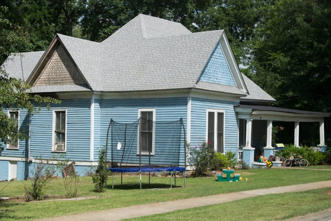 Camille makes two trips to the John Nash house and once drives right past his blue house.