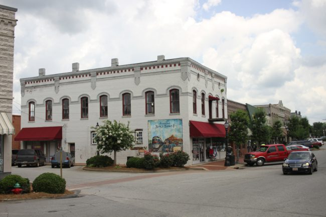 """Here are some shots of the downtore core of Barnesville, which transformed into Wind Gap for shooting purposes. According to the Georgia Film Commission team, """"The great thing about the ongoing series like Ozark or The Walking Dead or Stranger Things is that they go almost all year round. The Walking Dead set up in […]"""