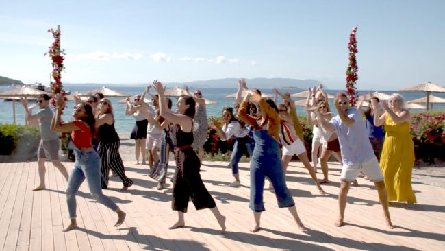 """The press was invited to take a dance lesson on Kastani Beach as assistant choreographer Lucy Bardrick taught us the steps to """"Dancing Queen"""" – the very same steps that Pierce Brosnan, Stellan Skarsgård and Colin Firth learned for Mamma Mia! Here We Go Again."""