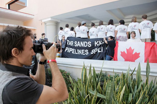 Revolution was the first film to platform the devastating effects of ocean acidification. Rob Stewart is pictured filming the indigenous environmental network protest at a UN Climate Conference (COP 16).