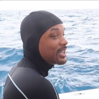 Will Smith swims with sharks