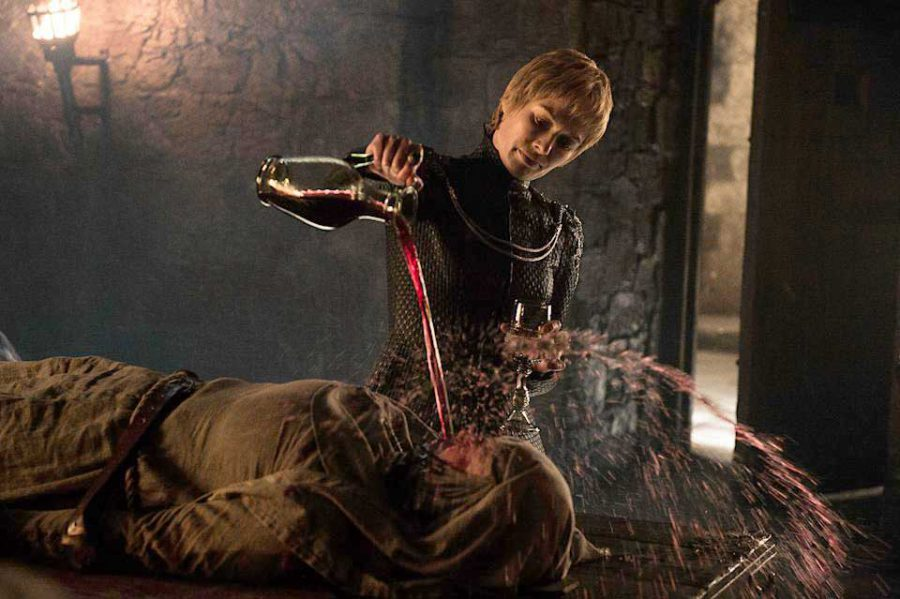Lena Heady as Cersei pouring wine on Hanna Waddington in a scene from Game of Thrones (photo credit: HBO)