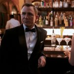 James Bond (Daniel Craig) and Paloma (Ana de Armas)