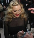 "Madonna signs autographs prior to the ""W.E.'' premiere held at Roy Thomson Hall"