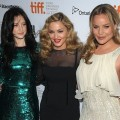 Andrea Riseborough, Madonna and Abbie Cornish pose on the red carpet prior to the W.E. premiere