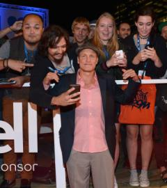 Woody Harrelson schmoozes with fans at LBJ premiere