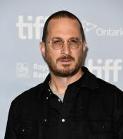 Darren Aronofsky posing for photos before the press conference