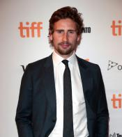 Edward Holcroft poses for photo