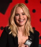 Jennifer Lawrence laughing while answering questions