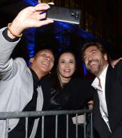 Javier posing for selfie with fans