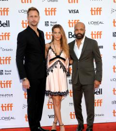 Alexander Skarsgard, Riley Keough on TIFF red carpet for Netflix film Hold the Dark
