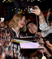 Léa Seydoux poses for fans on the Kursk red carpet