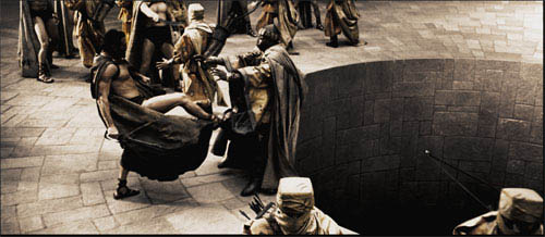 """Leonidas (GERARD BUTLER) personally delivers his answer to the Persian Messenger (PETER MENSAH) in Warner Bros. Pictures', Legendary Pictures' and Virtual Studios' action drama """"300,"""" distributed by Warner Bros. Pictures.   - Large"""