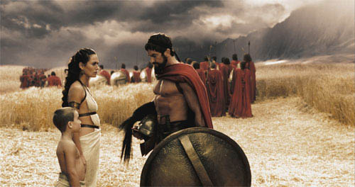 "Leonidas (GERARD BUTLER) bids farewell to his son Pleistarchos (GIOVANI ANTONIO CIMMINO) and wife Gorgo (LENA HEADEY) as the 300 begin their march north in Warner Bros. Pictures', Legendary Pictures' and Virtual Studios' action drama ""300,"" distributed by Warner Bros. Pictures. - Large"