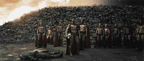 "Astinos (TOM WISDOM, third from left), Leonidas (GERARD BUTLER) and his Captain (VINCENT REGAN) look toward the distant Persian encampment as a wall of the day's dead rises behind them in Warner Bros. Pictures', Legendary Pictures' and Virtual Studios' action drama ""300,"" distributed by Warner Bros. Pictures. - Large"