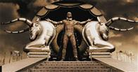 "Xerxes (RODRIGO SANTORO), the Persian king who claims to be a god, stands atop his elaborate golden litter in Warner Bros. Pictures', Legendary Pictures' and Virtual Studios' action drama ""300,"" distributed by Warner Bros. Pictures."