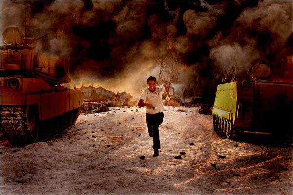 Shia LaBeouf running away from an explosion