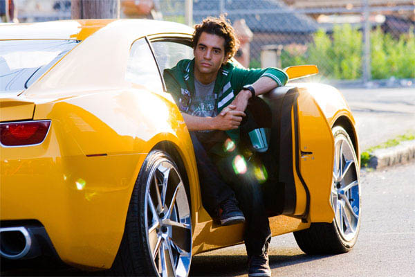 Ramon Rodriguez sitting in Bumblebee