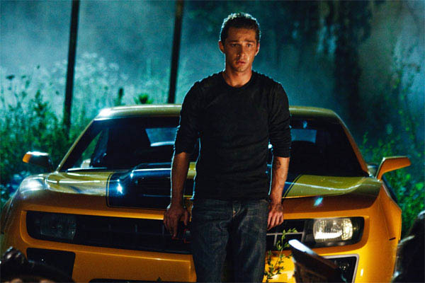 Shia LaBeouf in front of Bumblebee