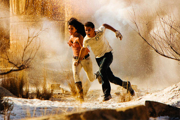 Shia LaBeouf and Megan Fox run from an explosion