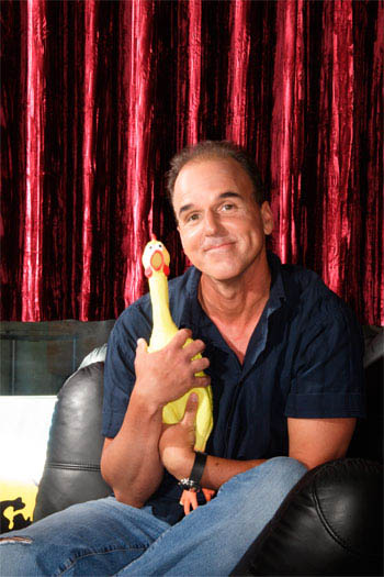"Writer/director/producer Steve Oedekerk (right), aided by his rubber chicken (left), shows what really happens down on the barnyard when the farmer turns his back in the animated feature  ""Barnyard."" - Large"