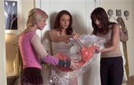 (left-right) Maggie (Samaire Armstrong), Ashley (Lindsay Lohan) and Dana (Bree Turner) are shocked when Ashley receives Sarah Jessica Parker's dress from the dry cleaner.